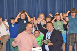 Edfund President, Jim Cooper, celebrates the iPad grant with Principal, Chris Heath, and several future recipients.